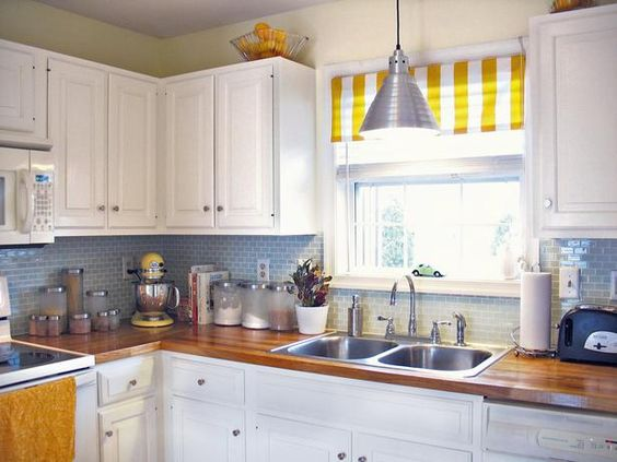 A lemon-yellow shade and butcher block countertop evoke sunshine and sand.