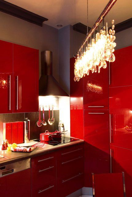I love the glossy red finish, but not the handles.  and a big Yes to the Chandelier.