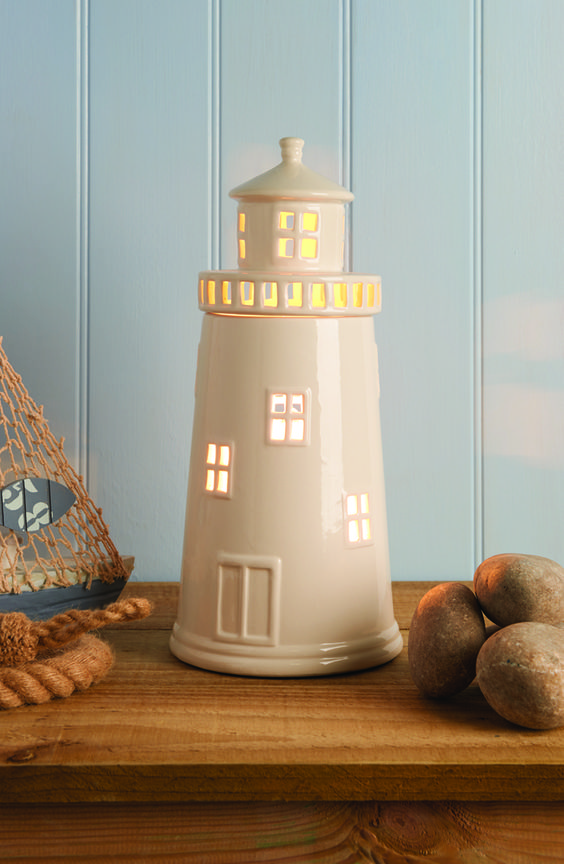 A fun and unique Lighthouse Lamp, this is perfect for a room with a nautical theme #nautical #lamp #lighthouselamp
