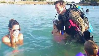 Soldier swims up, surprises family!