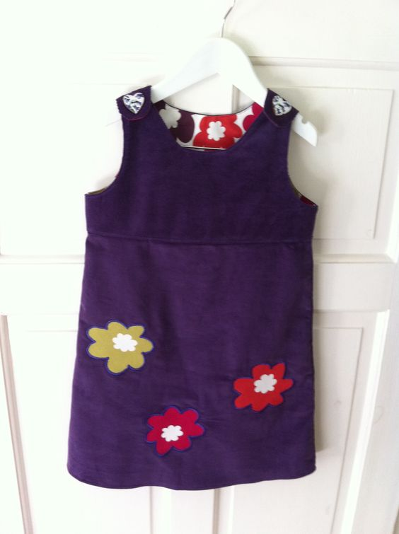 Appliqué of flowers from dress lining makes it less plain.