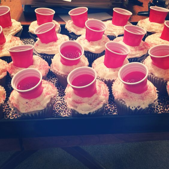Cupcakes I made for my sisters 21st birthday. Large cupcakes that I cut out small hole to stick the mini solo cup (found at Walmart) in that were filled with Jell-O shots and sprinkled with red sprinkles!