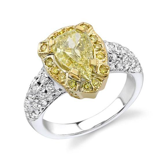 Modern Style Fancy Yellow Diamond Halo Engagement Ring. #ring #diamond #modern #bridal #wedding #engagement