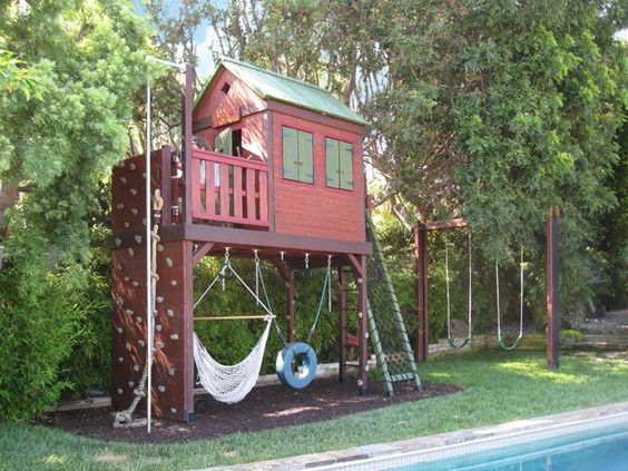 pictures of swing sets with climbing wall