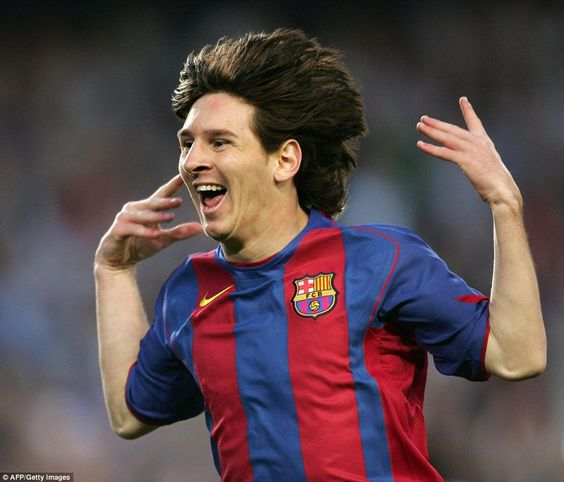 Messi celebrates his first goal for Barcelona after scoring against Albacete in a La Liga clash in May 2005