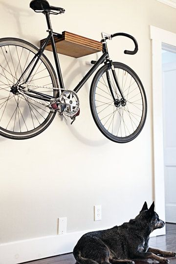 Bike shelf- because hanging a bike by two hooks get too complicated and causes the bike to scratch the wall.: