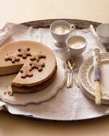 Gingerbread Cheesecake - decadent cheesecake that's topped with a whimsical ring of homemade gingerbread-men cookies.