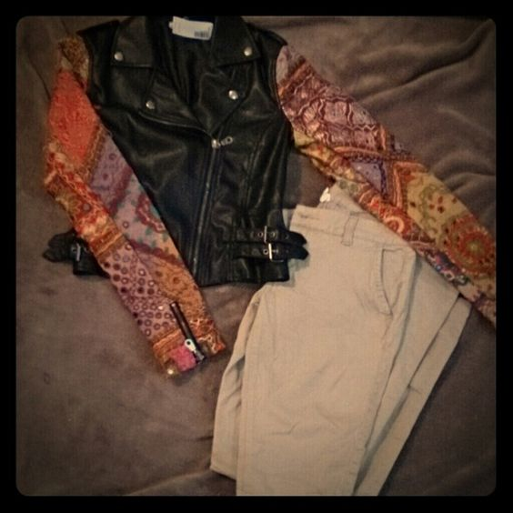 Unique leather jacket urban outfitters Black leather with colorful sleeves. I bout this while pregnant hoping I'd be able to wear it after but can't. I hate to get rid of it because I love it :-( came from urban outfitters! Ecote Jackets & Coats