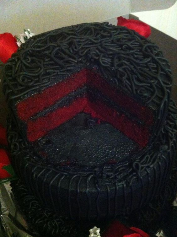 Red velvet cake with white purple and red icing