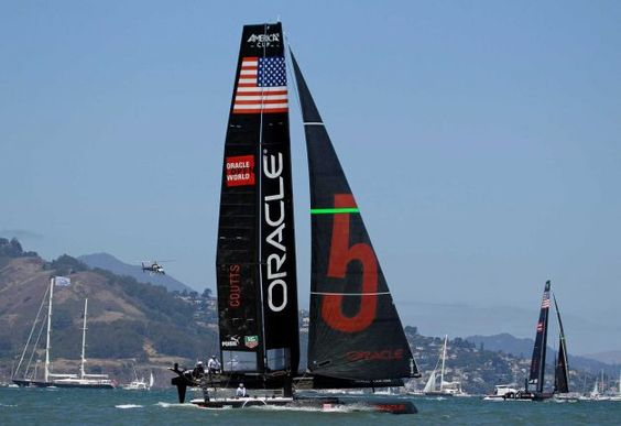 Oracle Team USA Coutts, left, and Oracle Team USA Spithill, right, race during the match finals of the America's Cup World Series sailing event in San Francisco. Oracle Corp. CEO Larry Ellison wants his sailing team to have a temporary winter base at a boat harbor on the Hawaiian island he recently purchased. Photo: Eric Risberg / AP