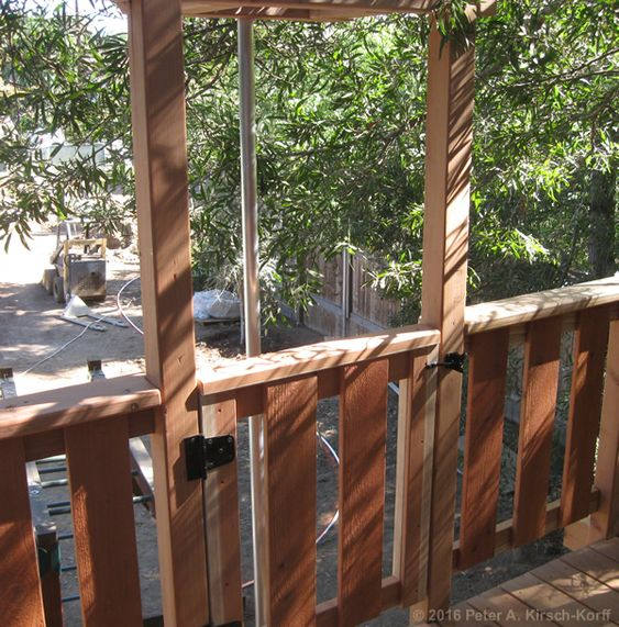 Greene & Greene Inspired Redwood Tree House detail of door to access the fireman's pole - Pasadena, CA