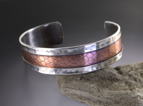 This will be my go to bracelet as soon as I make one for myself. I absolutely love it!  It goes with everything, dressed up or down.  A sterling silver folded frame holds a snakeskin textured copper interior.