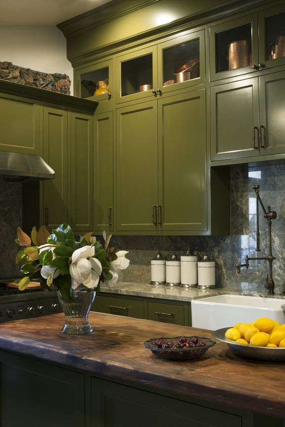 Windowless kitchen with olive green painted cabinets for Windowless kitchen ideas