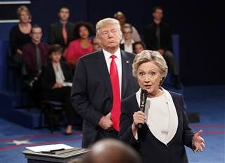 Democratic presidential nominee Hillary Clinton, right, speaks as Republican presidential nominee Donald Trump listens during the second presidential debate at Washington University in St. Louis on Sunday.