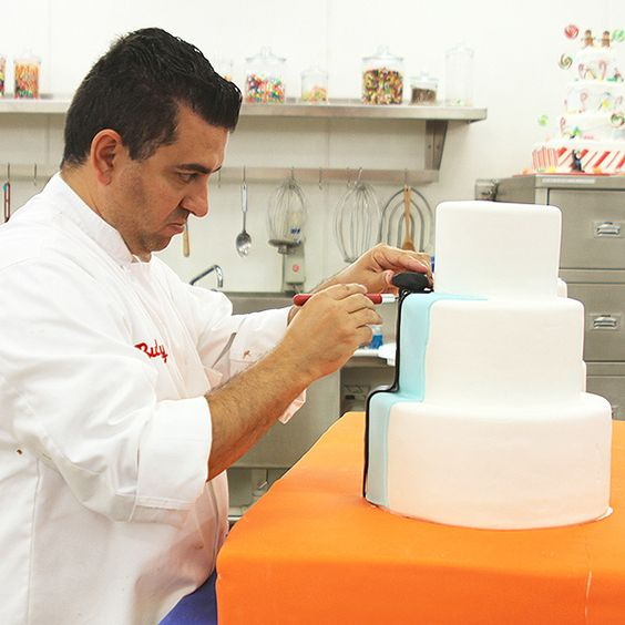 Buddy works on the cake for the hospital. #CakeBoss