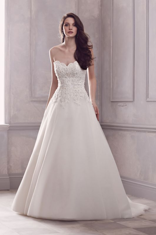 STYLE  4408 DESCRIPTION  Paloma Re-embroidered Lace and Tulle Strapless Wedding Gown. Scallop shaped neckline with beaded lace bodice. Full A-line tulle skirt with beaded lace appliqués cascading over skirt from bodice.  Sweep Train