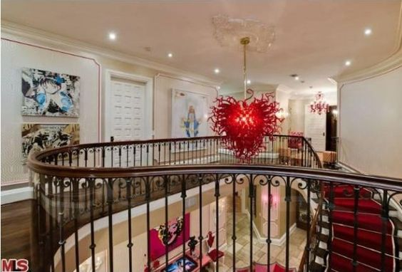 Landing in Christina Aguilera's home - love the chandelier!: