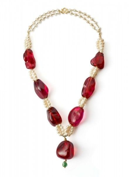 Spinels on a necklace of cultured pearls with dyed green beryl bead