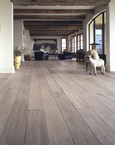 White washed hardwood floor and rustic beams - Love this color. Would love to re-do my kitchen with this type/color of wood! I really like this hardwood because it's more if a cream gray/grey cool color.