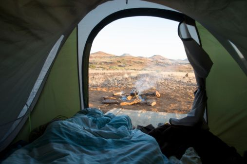 Stock Photo : Distant view of camp fire and scene, taken from within a tent, Sesfontein, Kaokoland, Namibia