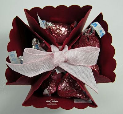 Great little gift for hostess or door prize, with ribbon or punch items in the pockets rather than the chocolates