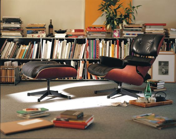 @vitra #Eames Lounge chair and ottoman in a book filled home office