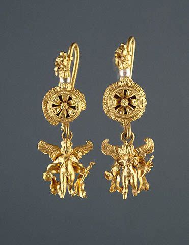 Disk pendant earrings with a figure of Eros    Greek, Alexandria, Egypt, 220 - 100 B.C.  Gold and pearls    The J. Paul Getty Museum