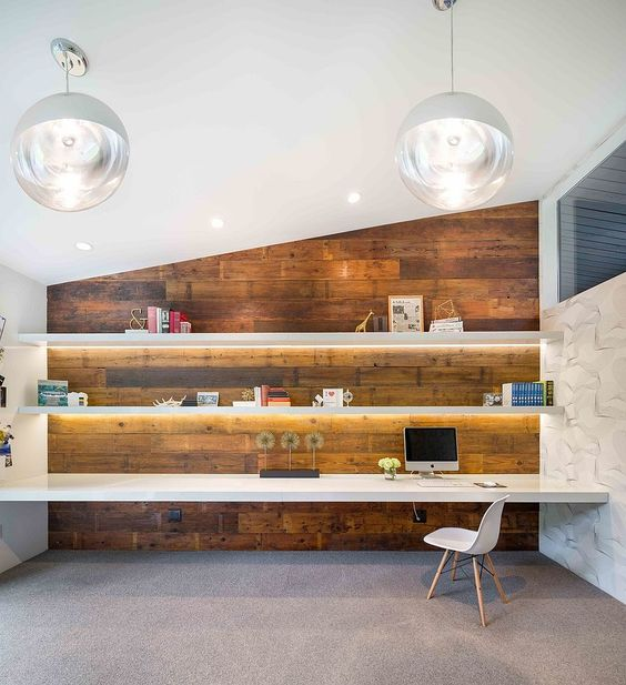 Gorgeously lit shelves and reclaimed wood wall create a stunning midcentury modern home office [From: Vanillawood]