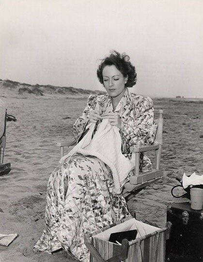 1940. Joan Crawford knitting on the set of 'Strange Cargo'.