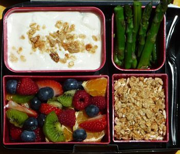 Feel Great Bento Lunch:   •Vanilla Yogurt  •Granola  •Mixed Fruit Salad  •Steamed Asparagus Spears   Fill your large lidded container with vanilla yogurt and sprinkle some of your granola on top.    Fill one of your medium containers with your favorite granola.    Fill your other medium container with steamed asparagus spears.   Create a fruit salad for your other large container. We chose strawberries, blueberries, raspberries, kiwi slices and orange for ours