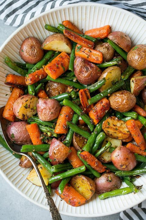 Garlic Herb Roasted Potatoes Carrots and Green Beans with Red Potato, Medium Carrot, Olive Oil, Fresh Thyme, Fresh Rosemary, Salt, Freshly Ground Black Pepper, Green Beans, Minced Garlic.