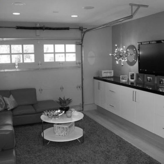 Garage converted to living space for a kids playroom or entertaining area. Uses original garage door. http://www.houzz.com/projects/73477/Unique-Garage-Space