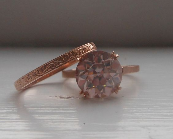Barely Pink OEC moissanite engagement ring in 14k rose gold with a hand engraved band.  Joseph Schubach Jewelers