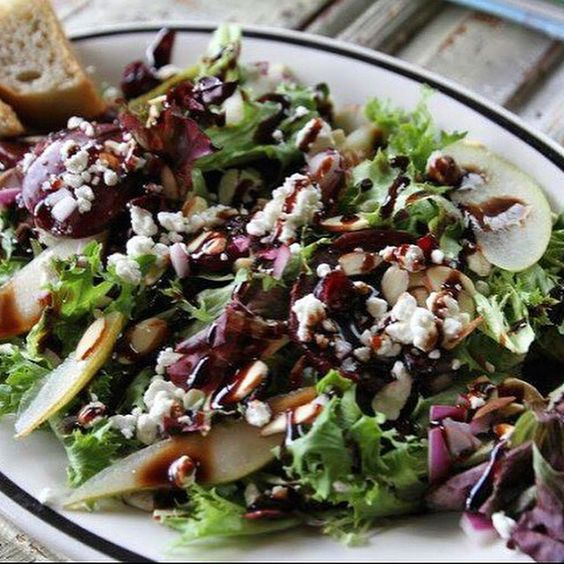 The Haviland at Thistle Stop Cafe is topped with Anjou pears, marinated beets, red onions, cranberries, almonds & goat cheese. Photo credit: Dana Storey  #nashville