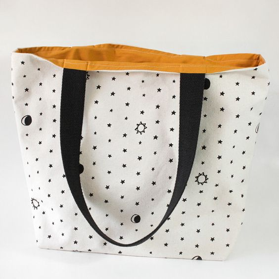 Star Tote. This tote is sturdy and built for utility but is also an attractive everyday on-the-go bag. The canvas is heavy and durable and it stands upright when empty or full. The straps are wide for shoulder carrying comfort. Seamless all-over 1 color screenprint. 100% cotton, machine washable but hand wash preferred, line dry. $38
