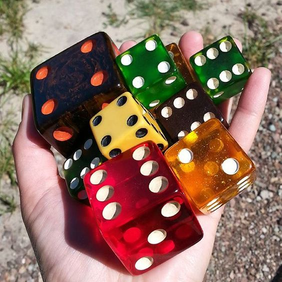 My little collection of really big vintage dice. All are bakelite with the exception of the stardust apples juice lucite.