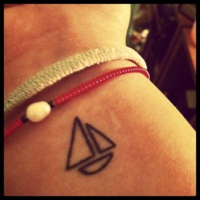 sweet and simple boat tattoo
