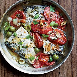 striped bass poached in white wine with tomatoes, olives, and herbs