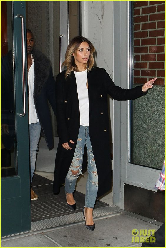 Kim Kardashian. boyfriend jeans, black pumps, white shirt and oversized peacoat.