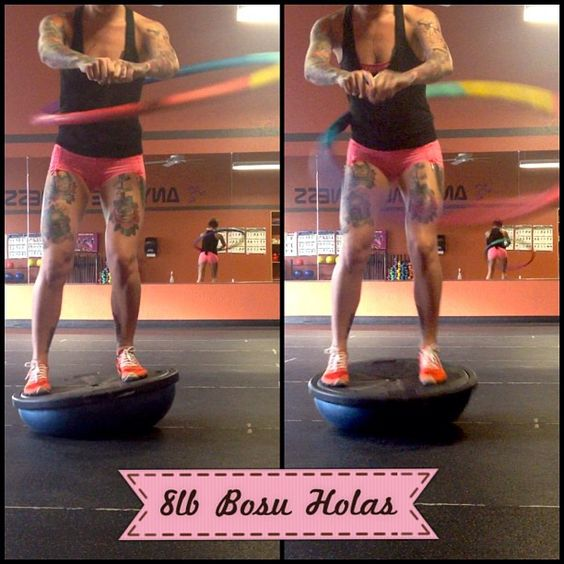 Want to seriously challenge your core strength? Grab a weighted hula hoop (yes a weighted hula hoop) and get to town on a bosu ball.  - Wow..that looks hard!
