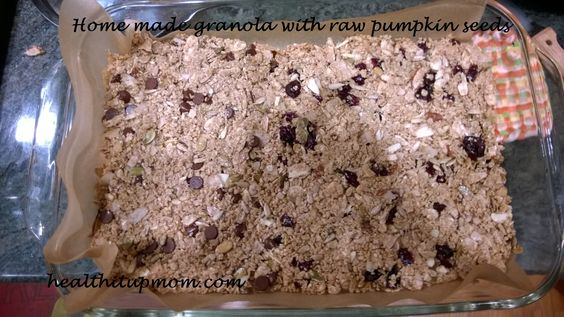 Home made granola with raw pumpkin seeds and dried cranberries (or whatever fruit or add-in you love!)