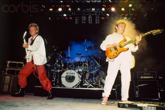 "The Police (1983) - performing ""Synchronicity I"", the opening title on their tour. Comiskey Park 1983 , an all day event! Including Joan Jett, Flock of Seagulls, The Fixx , Simple Minds"