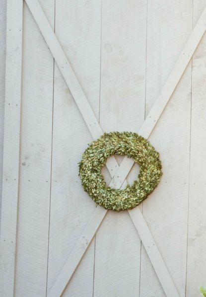 wreath on grey barn door