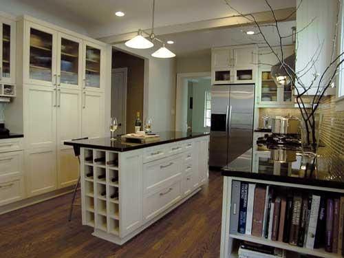 My favorite part the built in wine cubby in the kitchen for Antique white kitchen cabinets with black granite countertops