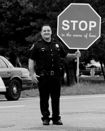 """Stop in the name of love"" signs were held by local policemen to escort traffic at this destination wedding on Long Beach Island, New Jersey"