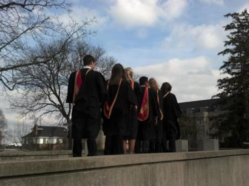 Winter convocation, 2012. Newly-minted alumni posing outside Creelman Hall.