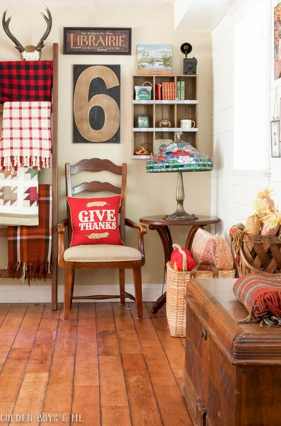 DIY ladder with plaid blankets and quilts and gallery wall - www.goldenboysandme.com