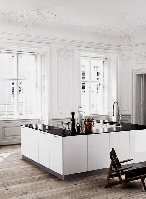 my favorite of all time... I like the space, placement, light in the long double windows, ceiling choice of white, minimal cabinets, flooring, and open visiting space!  Oh yea, and the black countertops!!!!!