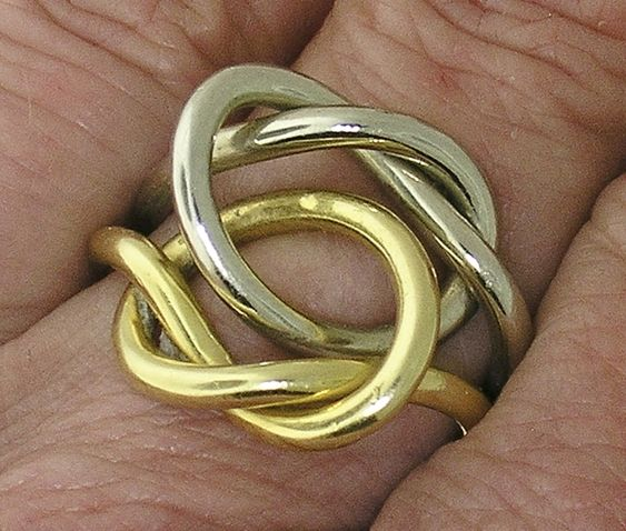 GUCCI 18k Yellow and White Gold DOUBLE KNOT Ring by myvintagediamondring on Etsy https://www.etsy.com/uk/listing/514802799/gucci-18k-yellow-and-white-gold-double