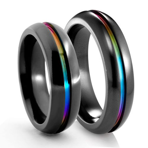 These black titanium rainbow banded wedding rings are undeniably futuristic and sci-fi.